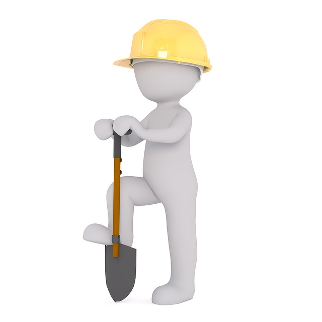 figure with hard hat and shovel